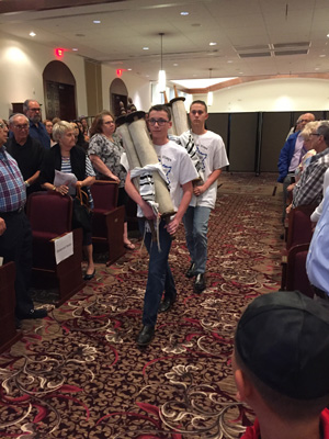 Hebrew School students marching with the Czech Scrolls at our Yom Hashoah Commemoration Ceremony.
